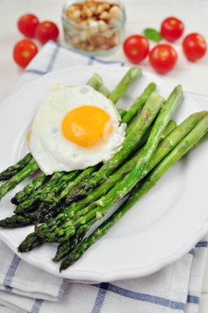 Green Asparagus with hard boiled egg photo