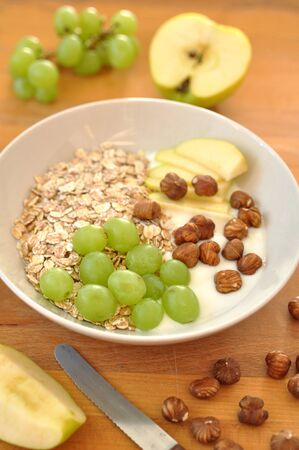 Granola with apple and grapes photo