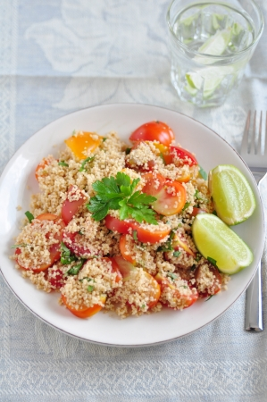 Couscous salad with tomatoes photo