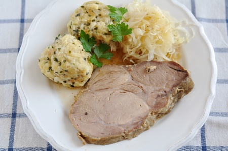 Roasted Pork with dumplings and sauerkraut photo