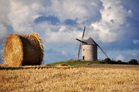 holland windmill: Le  de Moidre, Old windmill near Mont-Saint-Michel in France Stock Photo