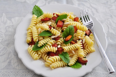 Pasta with pumpin, pine nuts and mint photo