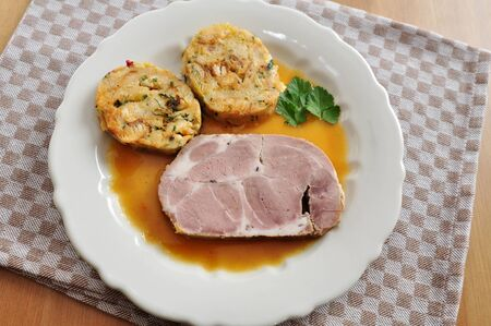 Roast Pork with german dumplings photo