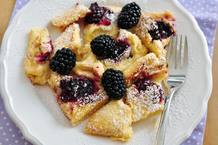 Kaiserschmarrn - German pancakes with blackberries photo