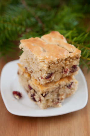 Christmas Blondies with cranberries and walnuts Stock Photo
