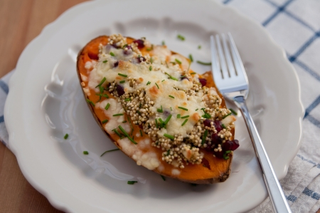 sweet course: Stuffed sweet potatoes with quinoa  Stock Photo