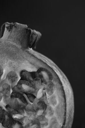 Pomegranate in black and white photo