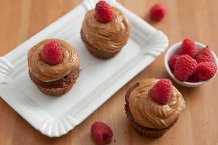Chocolate Cupcakes with raspberries photo