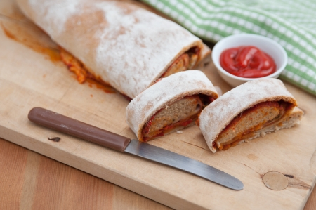 Italian Stromboli bread filled with ham and cheese photo