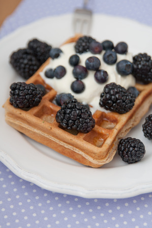 Waffles with whipped cream and berries photo