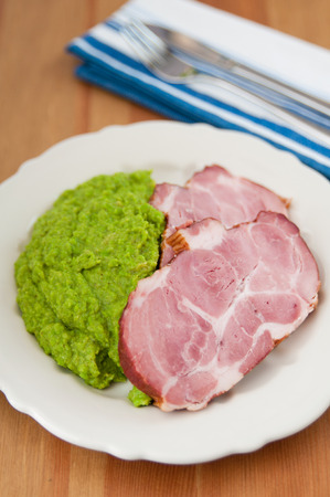 Smoked pork meat with mashed peas photo