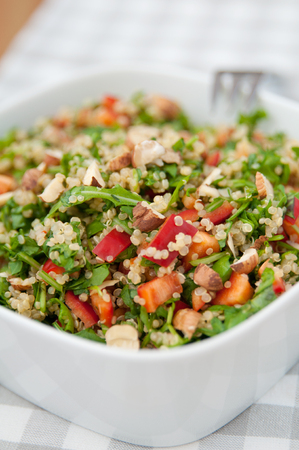 Organic Vegan Quinoa Salad with hazelnuts, arugula salad and red pepper photo