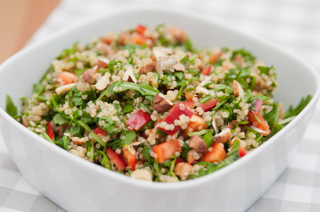 Organic Vegan Quinoa Salad with hazelnuts, arugula salad and red pepper