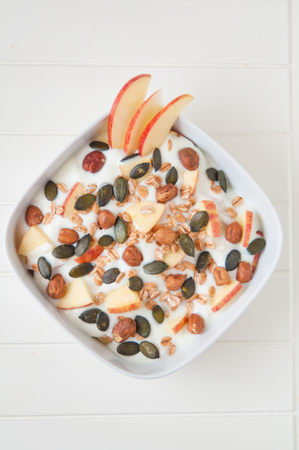Yoghurt with apple and pumpkin seeds photo