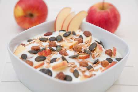 Yoghurt with apple and pumpkin seeds