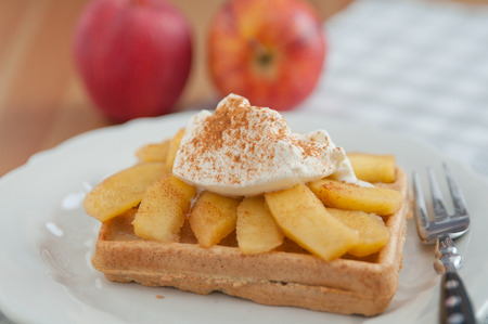 Waffles with whipped cream and cinnamon apples photo