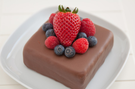 Chocolate Cake with fresh berries photo
