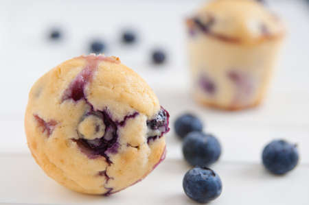 Blueberry Muffins on white wooden table photo