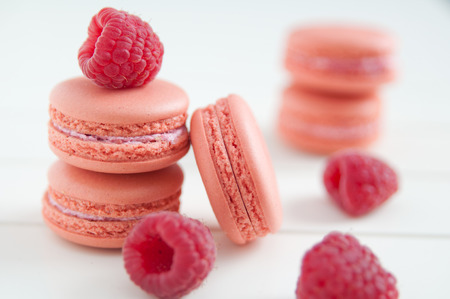French Macaroons on white wooden table photo