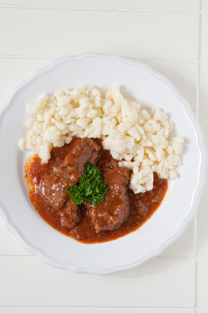 Goulash with dumplings photo
