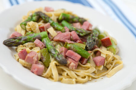 Pasta with asparagus and bacon photo