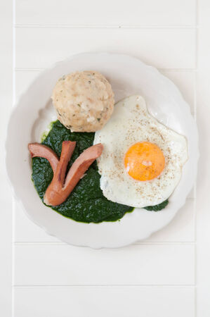 Spinach with sausage, egg and home made dumpling photo