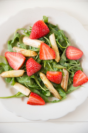 Healthy Strawberry Asparagus Salad on a white plate photo