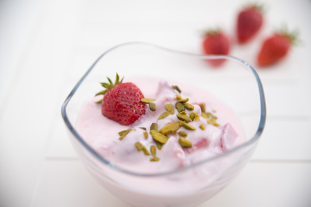Strawberry Yogurt with pistachios photo