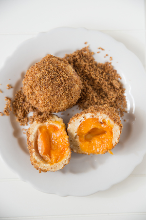 Sweet potato dumplings filled with apricots photo