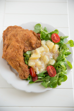 Grilled chicken leg with salad  photo