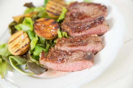 potato wedges: A juicy steak with potato wedges  Stock Photo