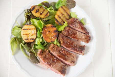 potato wedges: A juicy steak with potato wedges  Stock Photo