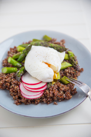 Quinoa with asparagus and poached egg photo