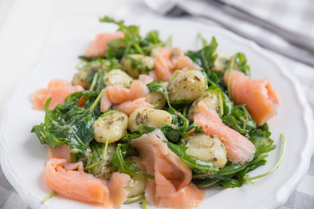durum wheat semolina: Gnocchi with salmon and arugula Stock Photo
