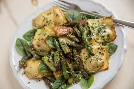 lemon wedge: Ricotta tortellini with green asparagus and fresh herbs