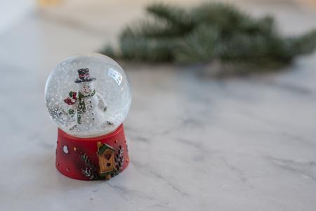 Snow globe with snow flakes