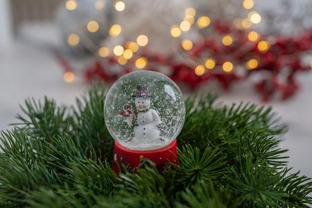 Snow globe with snow flakes Standard-Bild - 111901778