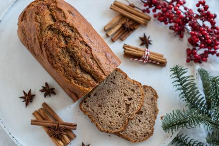 Banana bread with festive background Standard-Bild - 113104045