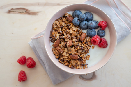 Healthy breakfast cereal concept with fresh fruit, granola, yoghurt