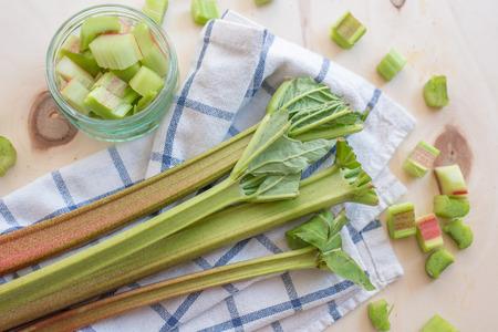 rhubarb stalks on a wooden chopping board 版權商用圖片