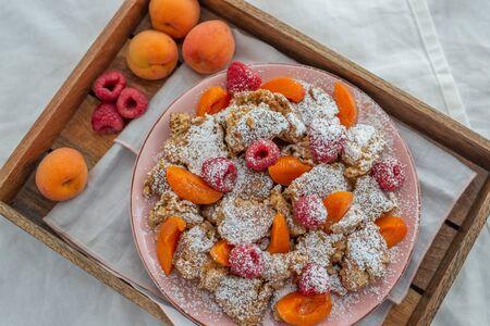 Kaiserschmarrn - traditional austrian pancake dessert with fresh fruit