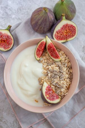 Oat granola with nuts, yogurt, honey, fresh figs and blueberries