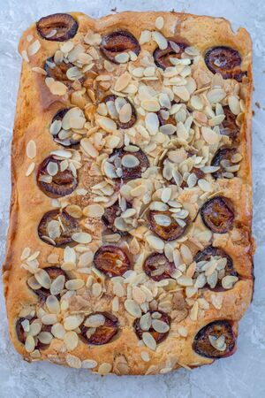 Home made rustic plum cake on a table