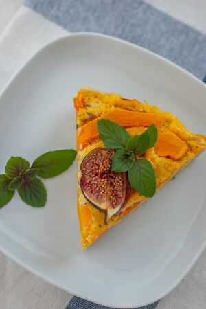 Home made pumpkin quiche lorraine on a table