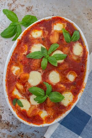 Home made baked italian gnocchi with tomato sauce and parmesan cheese