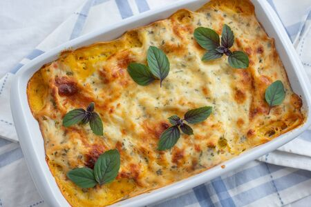 Recipe for homemade Italian lasagna with tomato sauce and meat