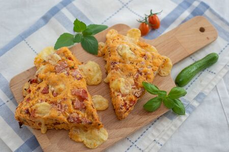 Savory cheese muffins with basil and sun-dried tomato