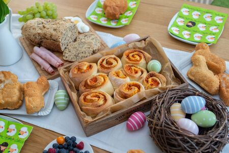 Easter holiday table. Easter cakes and colored eggs on a wooden table