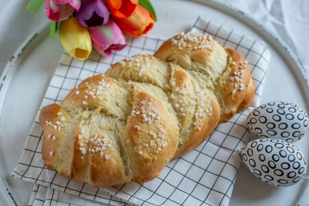Home made sweet braided bread on a wooden board
