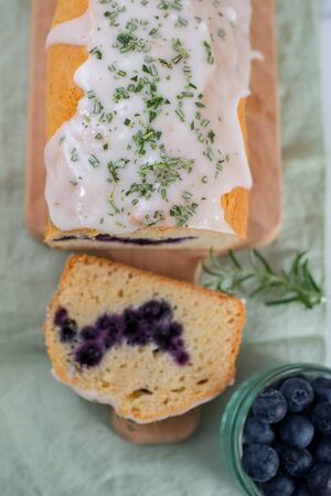 Sweet home made blueberry sponge cake with rosemary